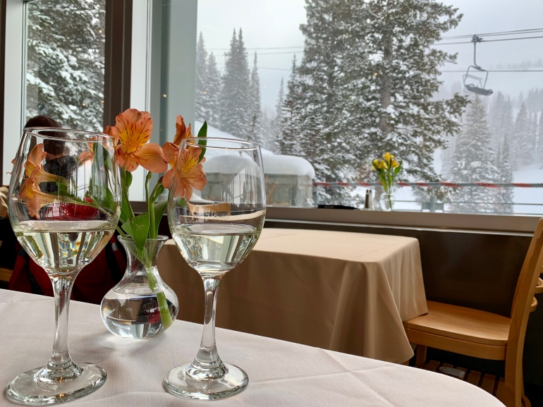 Enjoying wine with a view at Collin's Grill on the slopes of Brighton Ski Resort.