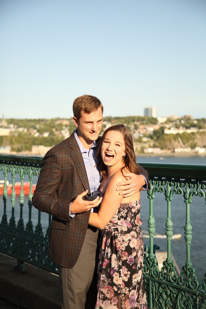 Getting engaged along the St. Lawrence River boardwalk in Quebec City, Canada