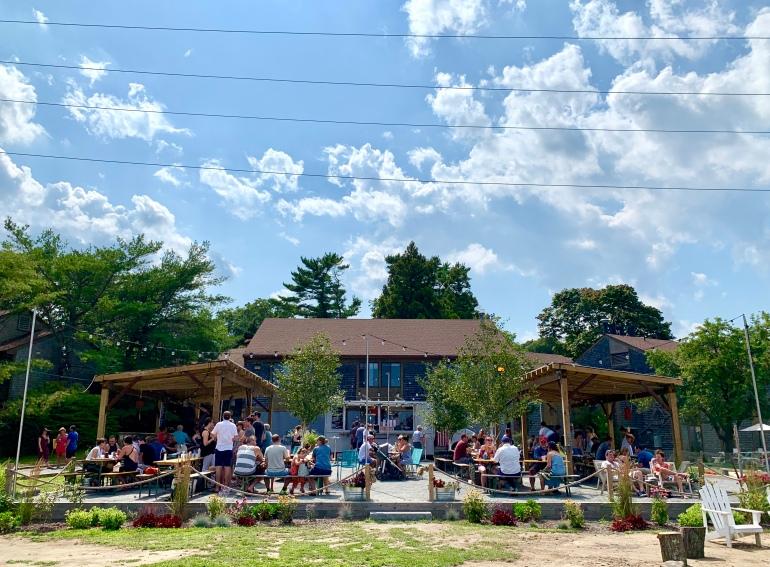People enjoying the Raw Bar at Island Creek Oyster Farm
